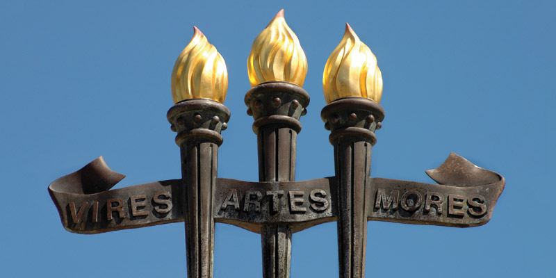 Vires Artes Mores Torches